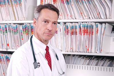 Doctor in front of medical records