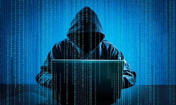 Hooded hacker on the dark web