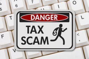 Tax Scam Sign on Keyboard