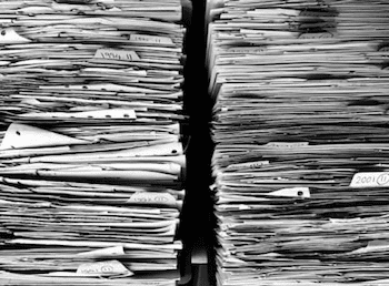 Pile of documents representing retention schedules